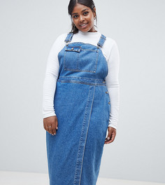 ASOS DESIGN Curve denim midi dungaree dress in midwash blue - Синий