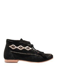 Полусапоги и высокие ботинки Soludos