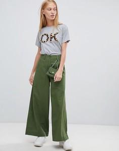 Широкие брюки цвета хаки со съемной сумкой ASOS DESIGN - Зеленый