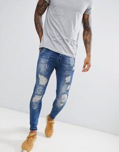 Темно-синие джинсы скинни с заниженной талией и принтом в виде брызг краски SikSilk - Синий