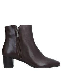 Полусапоги и высокие ботинки Voltan