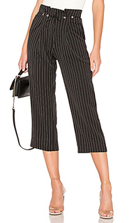 Chloe pleated pant - About Us