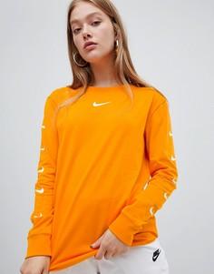 Лонгслив с логотипом на рукаве Nike - Оранжевый