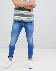 Синие зауженные джинсы с необработанными краями Celio - Синий