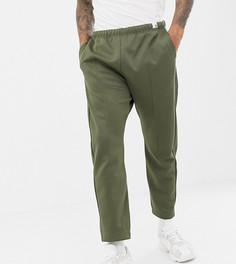 Спортивные штаны оливкового цвета adidas Originals XBYO - Зеленый
