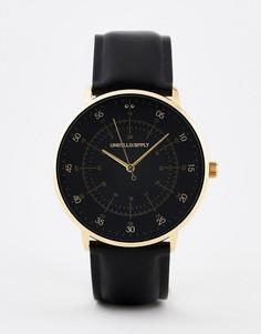 Черные часы с ремешком из искусственной кожи и золотистой отделкой ASOS DESIGN - Черный