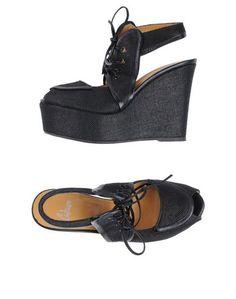 Обувь на танкетке CastaÑer