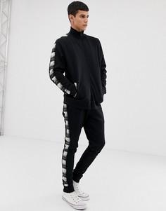 Спортивный костюм из трикотажной куртки и джоггеров скинни с полосками в клетку ASOS DESIGN - Черный