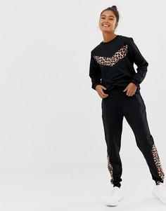 Спортивный костюм из свитшота с анималистичным принтом на вставках и джоггеров скинни ASOS DESIGN - Черный