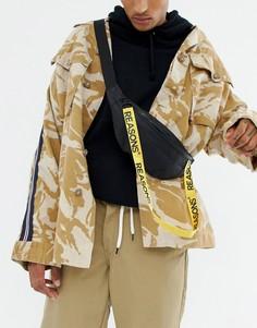 Черная сумка-кошелек через плечо с надписью на ремешке ASOS DESIGN - Черный