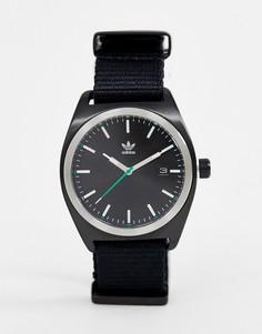 Черные часы с парусиновым ремешком Adidas Z09 Process - Черный