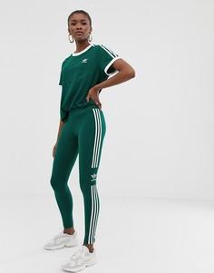 Зеленые леггинсы с тремя полосками adidas Originals adicolor - Зеленый