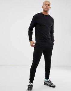 Черный спортивный костюм в рубчик из свитшота и зауженных джоггеров ASOS DESIGN - Черный