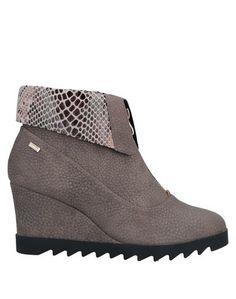 Полусапоги и высокие ботинки Roccobarocco