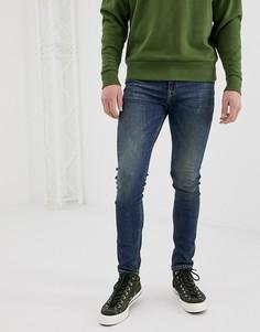 Темные супероблегающие джинсы ASOS DESIGN - Синий