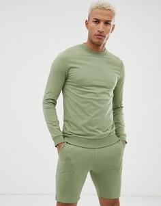 Зеленый спортивный костюм из свитшота и шортов скинни ASOS DESIGN - Зеленый