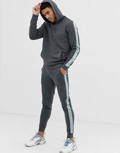 Черный выбеленный спортивный костюм из худи и зауженных джоггеров с атласными полосками по бокам ASOS DESIGN - Черный