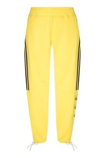 Желтые брюки Tourney Trefoil Adidas