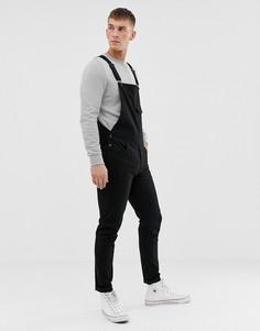 Черный джинсовый комбинезон зауженного кроя ASOS DESIGN - Черный