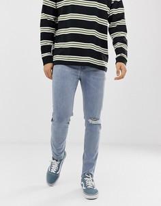 Светло-синие джинсы скинни с прорехами плотностью 12,5 унций ASOS DESIGN - Синий