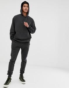 Черный спортивный костюм из oversize-худи и зауженных джоггеров ASOS DESIGN - Черный