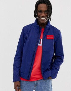 Куртка из технической ткани с капюшоном и логотипом Calvin Klein Jeans - Синий