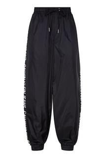 Черные брюки с логотипами Calvin Klein