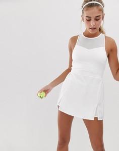 Белое теннисное платье с высоким воротом и плиссированной юбкой South Beach - Белый