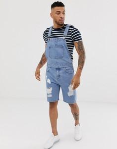 Светлый выбеленный джинсовый комбинезон с шортами и рваной отделкой ASOS DESIGN - Синий