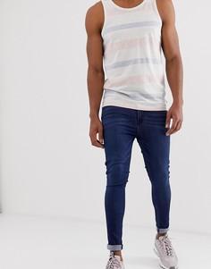 Темно-синие эластичные джинсы ASOS DESIGN - Синий