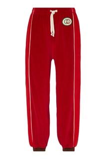 Широкие спортивные брюки красного цвета Gucci