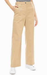 Хлопковые бежевые брюки с карманами Lacoste