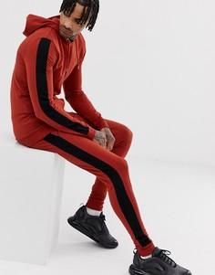 Спортивный костюм рыжего цвета из худи и джоггеров облегающего кроя с полосой по бокам ASOS DESIGN - Оранжевый