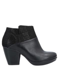 Полусапоги и высокие ботинки Dansko