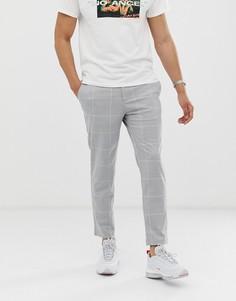 Светло-серые укороченные брюки скинни в клетку Bershka - Серый