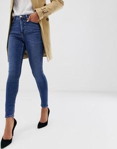 Темные выбеленные джинсы скинни с завышенной талией и застежкой на пуговицы ASOS DESIGN - Ridley - Синий
