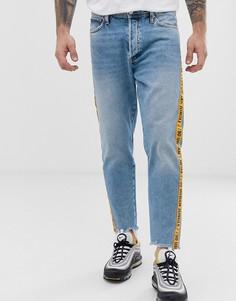 Суженные книзу джинсы с отделкой кантом с надписью Jack & Jones Intelligence - Синий