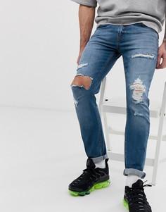 Выбеленные синие рваные джинсы скинни ASOS DESIGN - Синий