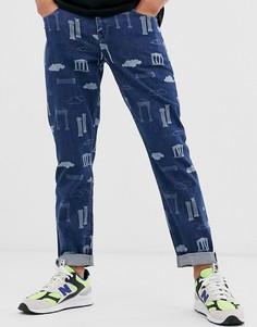 Суженные книзу темные джинсы в винтжном стиле с принтом ASOS DESIGN - Синий