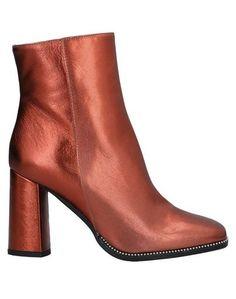 Полусапоги и высокие ботинки NIŪ