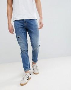 Темные суженные джинсы с рваной отделкой ASOS DESIGN-Синий