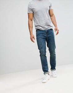 Темно-выбеленные джинсы скинни ASOS DESIGN-Синий