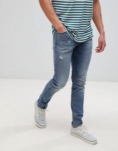 Темно-синие джинсы скинни с рваной отделкой ASOS DESIGN-Синий
