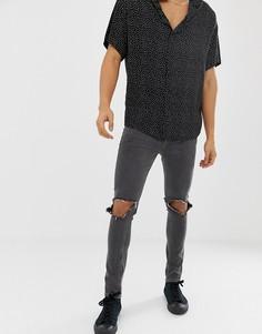 Черные выбеленные джинсы скинни ASOS DESIGN-Черный