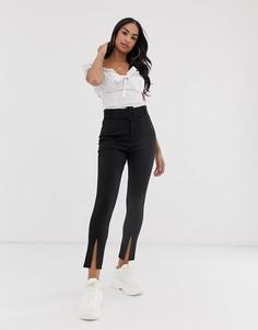 Зауженные брюки с пряжкой и разрезами у кромки ASOS DESIGN-Черный