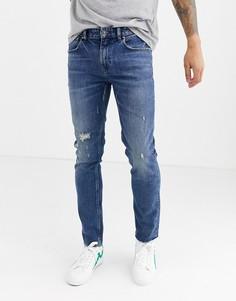 Синие джинсы скинни с рваной отделкой и необработанными краями ASOS DESIGN Cone Mill Denim American classic-Синий