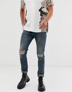 Синие выбеленные джинсы скинни из денима плотностью 12,5 унции с рваной отделкой на коленях ASOS DESIGN-Синий