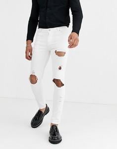 Белые джинсы скинни с рваной отделкой ASOS DESIGN-Белый