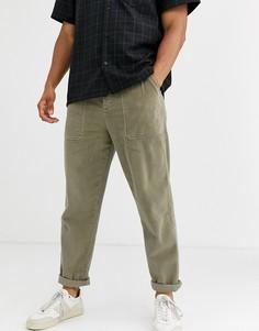 Выбеленные свободные вельветовые брюки цвета хаки с карманами в стиле милитари ASOS DESIGN-Зеленый