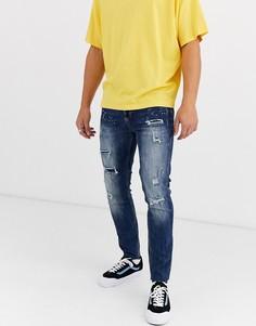 Темные джинсы скинни 7/8 с принтом брызг краски и необработанными краями Sixth June-Синий